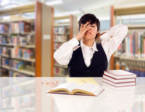 Young Teen Mixed Race Student Stressed and Frustrated In Library Royalty Free Stock Photo