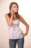 Young teen model. Young teen holding and talking on the phone Royalty Free Stock Image