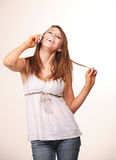 Young teen model. Young teen holding and talking on the phone Stock Photo