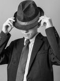 Young Teen posing in Hat, Suit and Tie. I did it my way - evoking Frank Sinatra, a boy dressed in a black suit and hat with a vintage feel Royalty Free Stock Images
