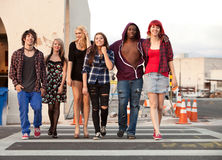 Young Teen Punks Crossing Street. Young teen punks walk happily together across the street Royalty Free Stock Photography