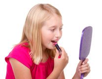 Young teen putting on lipstick Royalty Free Stock Image