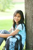 Young teen relaxing outdoors royalty free stock photos