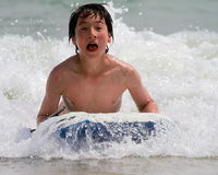 Young teen rides the waves Stock Image