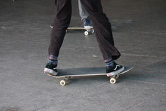 Young teen on skateboard in skate park Stock Photos