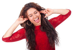 Young teen slapping ears and smiles Stock Photography