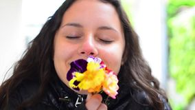 Young teen smelling bunch of flowers Stock Photos