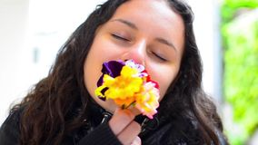 Young teen smelling flower Stock Photo