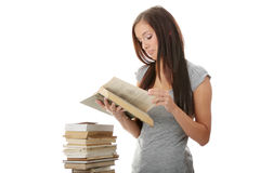 Young teen student woman reading a book Royalty Free Stock Images