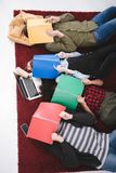 young teen students lying on carpet with notebooks royalty free stock photography