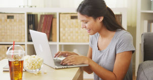 Young teen using laptop and smiling Royalty Free Stock Photo