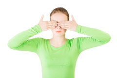 Young teen woman covering her face with hands Stock Photos