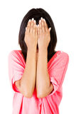 Young teen woman covering her face with hands Royalty Free Stock Photos
