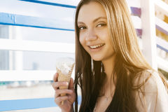 Young teen woman eating ice-cream, marina style Stock Photography