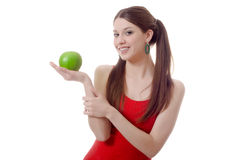 Young teen woman pigtails apple isolated Stock Photo