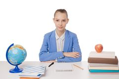 Young teen woman sitting behind the desk isolated Royalty Free Stock Photo