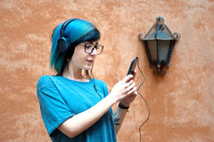Young teen woman using mobile phone outdoor Royalty Free Stock Images