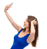 Young teenade girl make self portrait selfie with her mobile cel Stock Photo