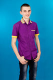 Young teenage boy on a blue background Royalty Free Stock Photo