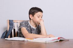Young teenage boy doing his homework. At home Royalty Free Stock Image