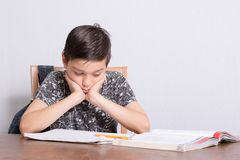 Young teenage boy doing his homework. At home Stock Photos