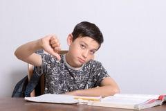 Young teenage boy doing his homework royalty free stock photo