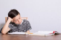 Young teenage boy doing his homework Royalty Free Stock Image