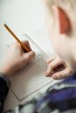 Young teenage boy doing homework Royalty Free Stock Photo
