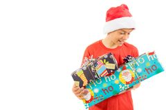 Young teenage boy wearing a Santa Christmas hat with a gift Royalty Free Stock Image