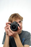 Young teenage boy holding Digital SLR Camera Royalty Free Stock Photo