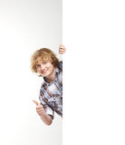 A young teenage boy holding a large white banner Royalty Free Stock Image