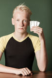 Young teenage boy holding up packs of tablets Stock Photo