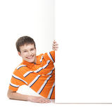 A young teenage boy holding a white banner Royalty Free Stock Images