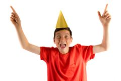 Young teenage boy isolated on white. Celebrating at a party royalty free stock photos