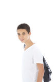 Young teenage boy with kit bag. Young teenage boy standing sideways with a kit bag slung over his shoulder isolated on white Stock Image