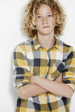 Young teenage boy standing in studio Royalty Free Stock Images