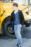 Young teenage boy waiting for bus to go home. Stock Images