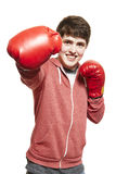 Young teenage boy wearing boxing gloves smiling Stock Image