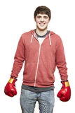 Young teenage boy wearing boxing gloves smiling Royalty Free Stock Images