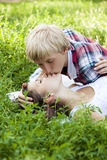 Young teenage couple in green park. Stock Images