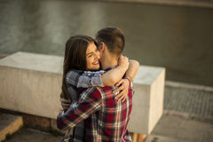 Young teenage couple hugging by the city river Royalty Free Stock Photography
