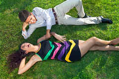 Young teenage couple relaxing on the grass Stock Photos