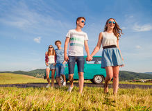 Young teenage couples in love outside against blue sky Stock Photography