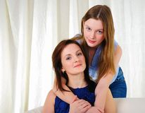 A young teenage daughter with a mother Royalty Free Stock Image
