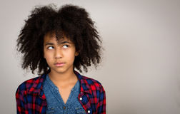 Young Teenage Girl With Afro Hair Thinking Royalty Free Stock Photography