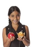 Young teenage girl with an apple and a muffin Stock Photo