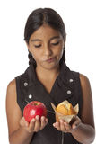 Young teenage girl with an apple and a muffin Stock Photography