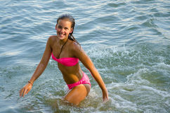 Young teenage girl bathing in the river in summer Royalty Free Stock Photo