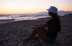 Young teenage girl on the beach at sunset Royalty Free Stock Images