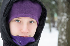 Young teenage girl in black down jacket Stock Photos